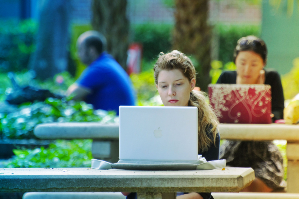 Students working outside at computers
