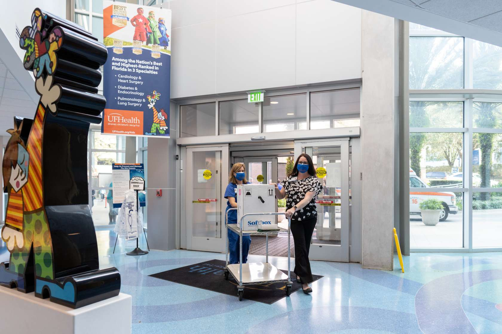 The first COVID-19 vaccine arriving at UF Health in Gainesville, FL (December 14, 2020)